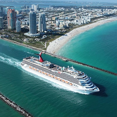 an aerial view of carnival glory departing from miami