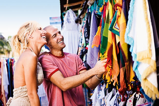 a couple shopping at a port during a carnival cruise