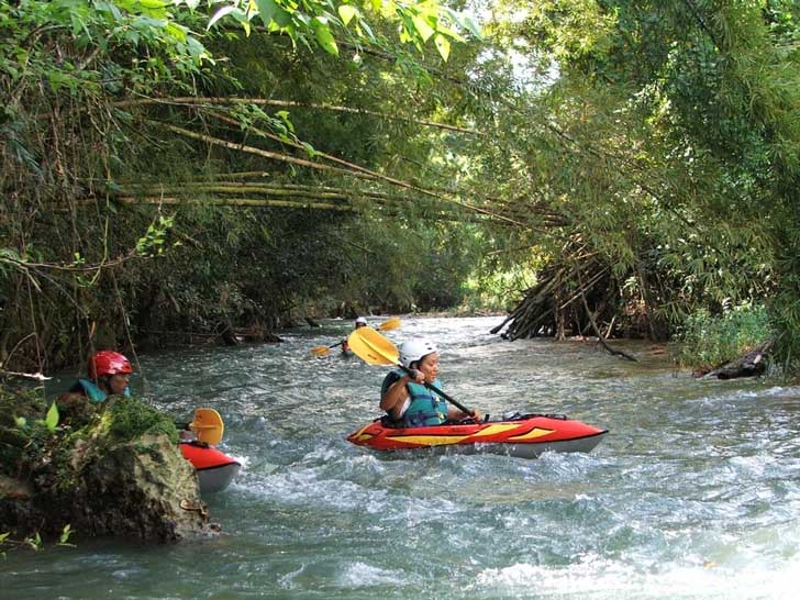 small group kayaking through the great river in the secluded chukka jungle