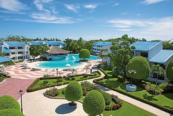 pool with a bar surrounded by luxury rooms at sunscape resort in puerto plata
