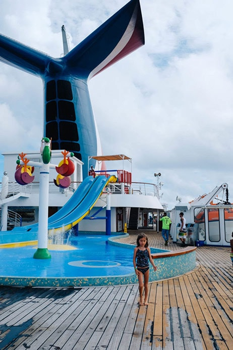 Drea's daughter with waterslide and Carnival fin in background