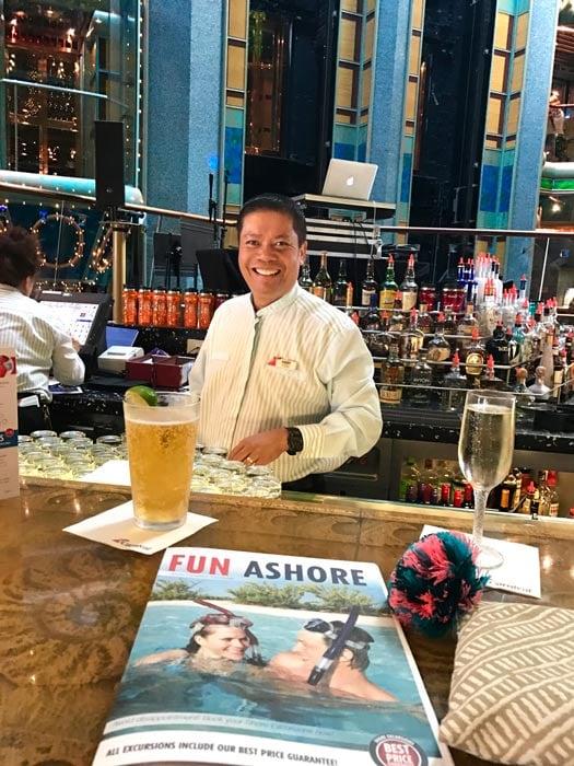 bartender smiling behind bar