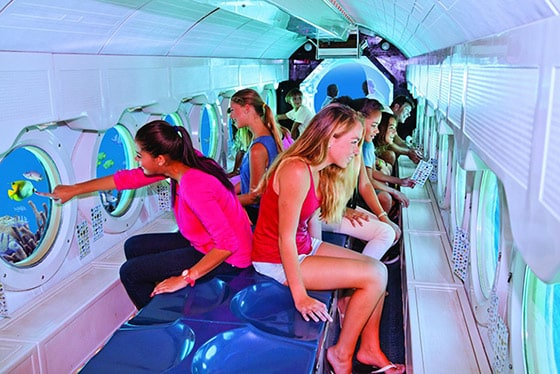 kids and adults onboard atlantis submarine viewing the underwater world of arubas coast line