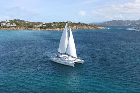 a catamaran sailing off the coast of st thomas