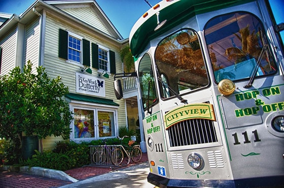 hop on & hop off trolly stops in front of the key west's butterfly and natural conservatory