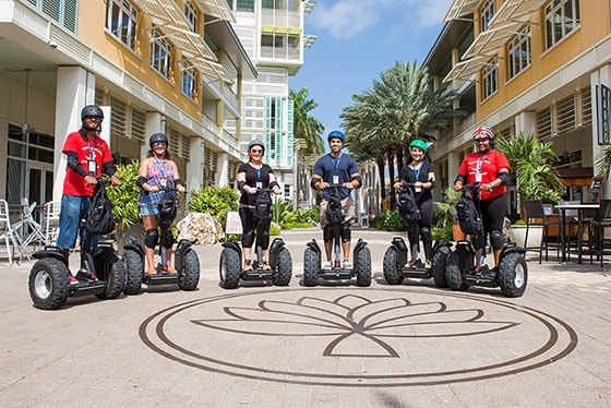 group of people on segways, exploring grand cayman