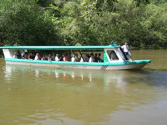 people sailing the tortuguero canals, exploring the jungle of limon