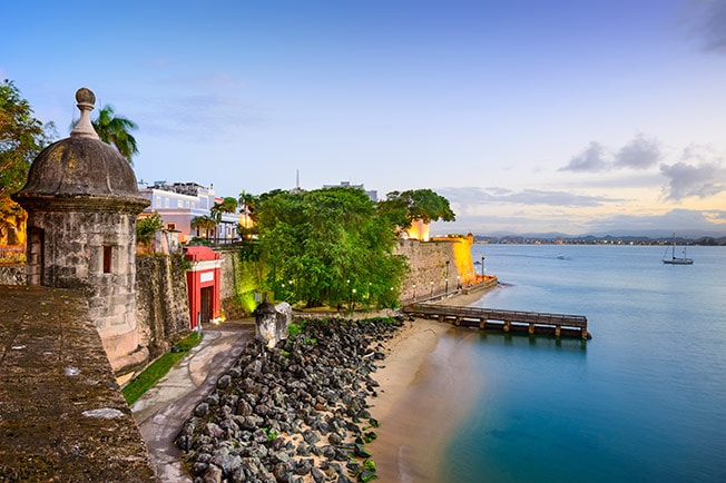 fortress walls on the shore of San Juan during the sunset