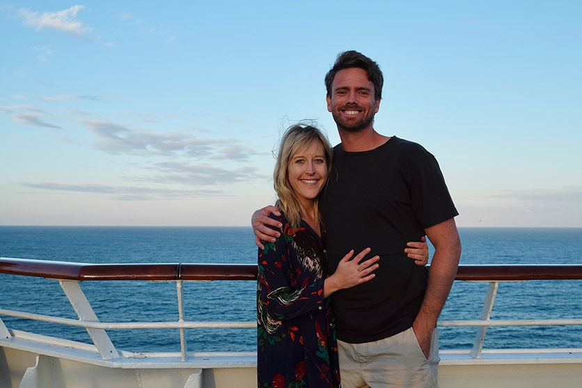 couple posing on ship deck