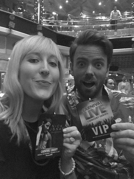 couple with nick jonas vip badges in black and white