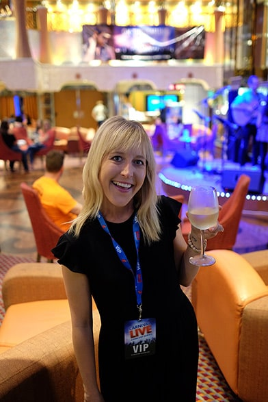 wife holding wine with vip badge