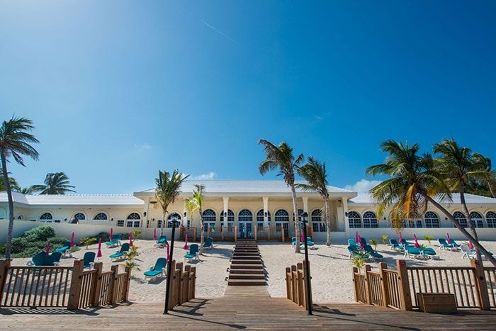 great gatsby inspired mansion at the edge of the beach in grand cayman