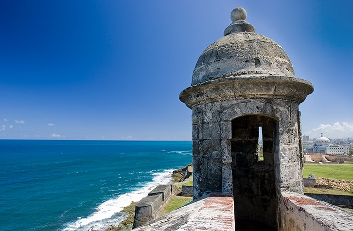 small guard tower on top of the san cristobal fort over looking the atlantic ocean