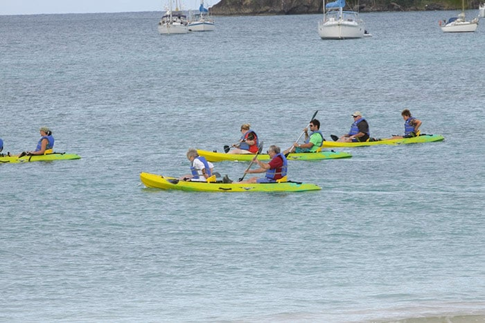 people kayaking in groups of twos off the shore of pigeon island
