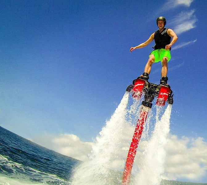 man shooting out of the water on a flyboard in st thomas
