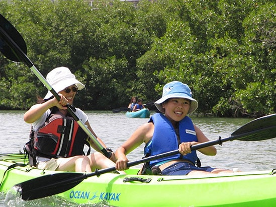 mother and son kayaking in st thomas' mangrove wildlife refuge & marine sanctuary