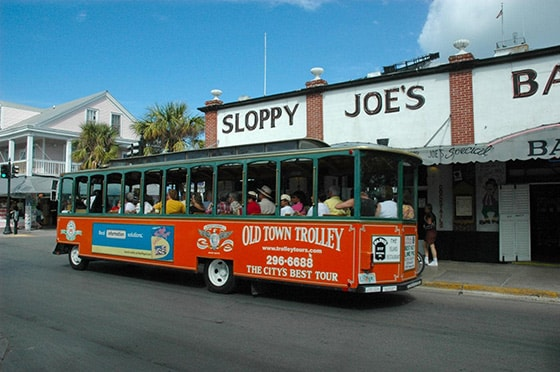 old town trolley driving past sloppy joes during a tour of key west