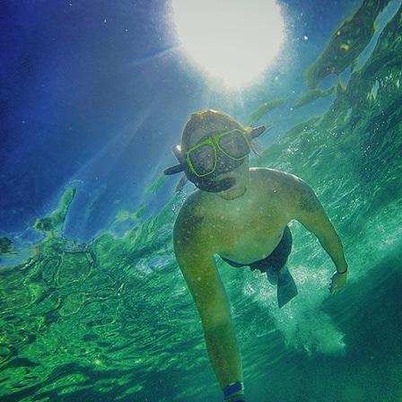 man taking a selfie as he snorkels in st lucia