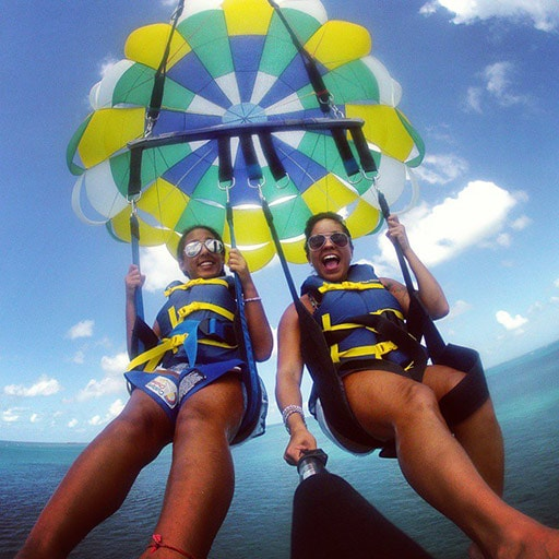 two women taking a selfie while parasailing off the coast of st thomas