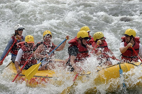 people white water rafting the powerful rapids of reventazon river