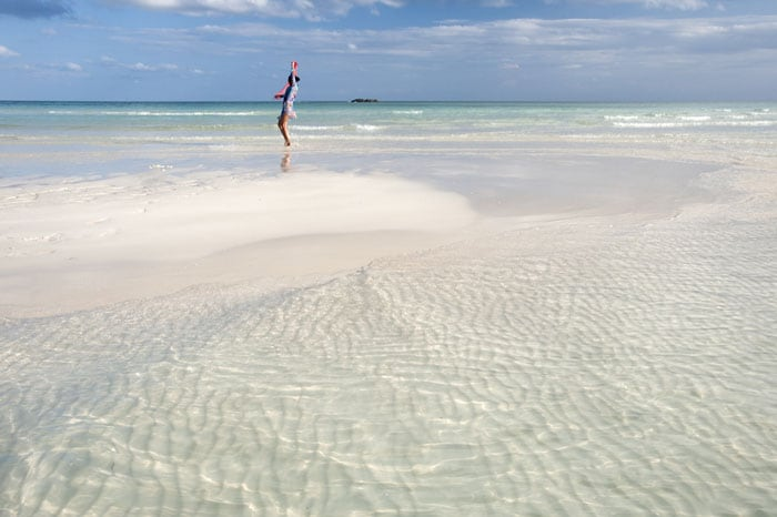 woman dancing on a bahamian beach in freeport