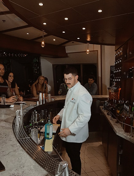Nick Jonas bartending at Alchemy Bar