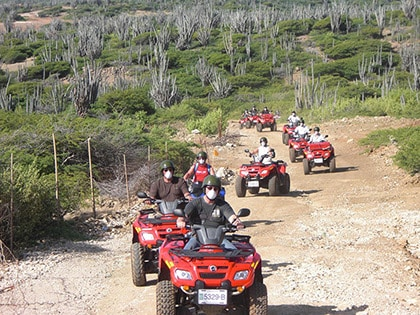 group of people exploring the east coast of Bonaire on ATVs