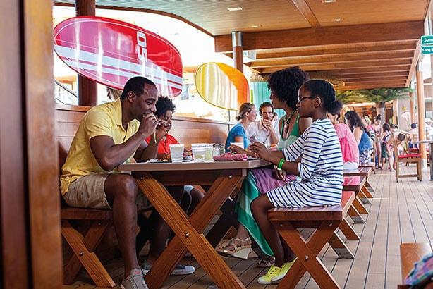 family enjoying a burger from guys burger joint