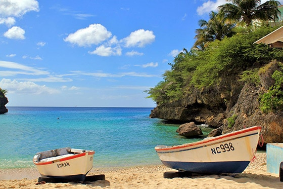 2 fishing boats parked on the sand of Playa Forti, Curacao