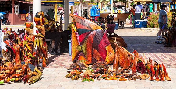 wood carvings in various sizes being sold in montego bay