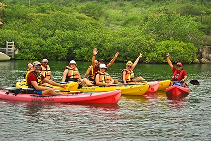 group of people kayaking along the Spanish Waters in Curacao