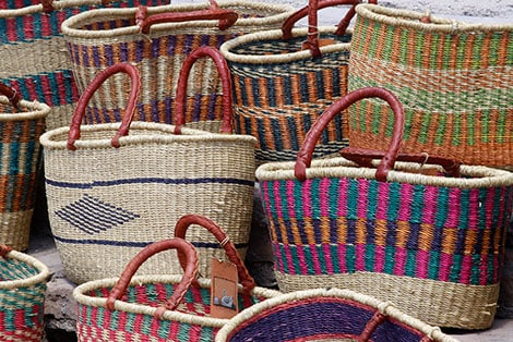 variety of straw baskets with different colors and designs