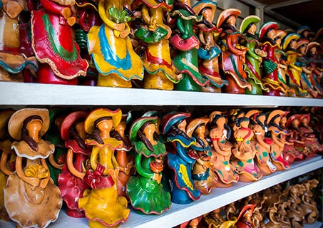rows of munecas lime souvenirs, faceless dolls, from dominican republic