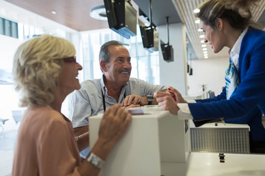 elder couple checking in at a cruise port