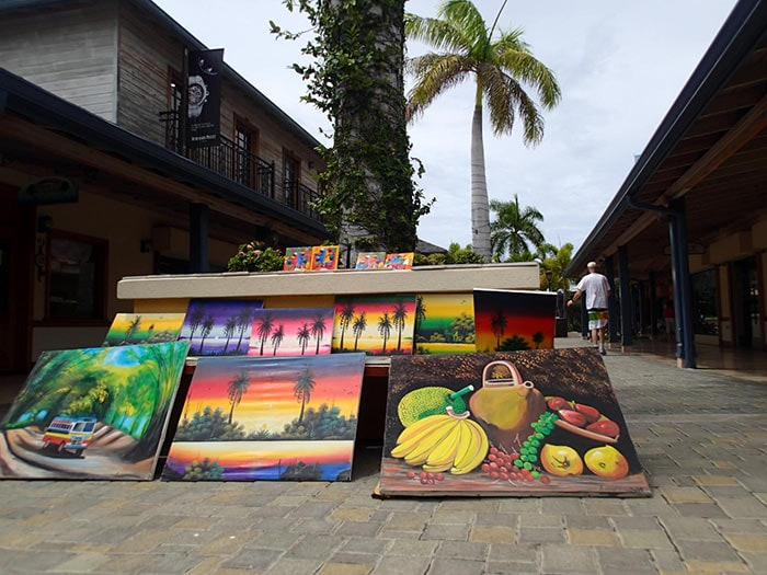 several jamaican paintings being sold on the streets of montego bay