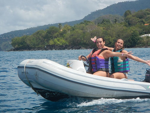 two women driving boat to St. George's lagoon in Grenada