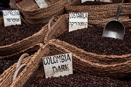 bags of different kinds of coffee including costa rican, colombian, and expresso