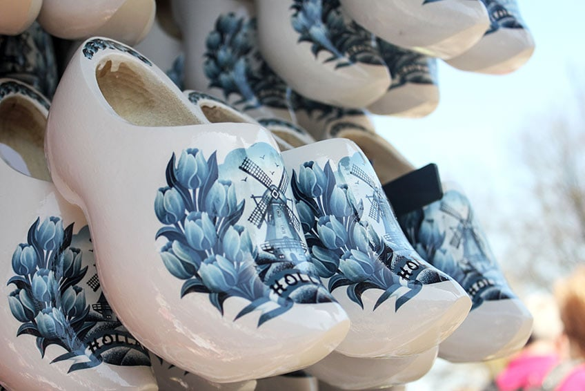 blue and white ceramic dutch shoes with windmills printed on top