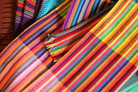colorful woven fabrics and clothing