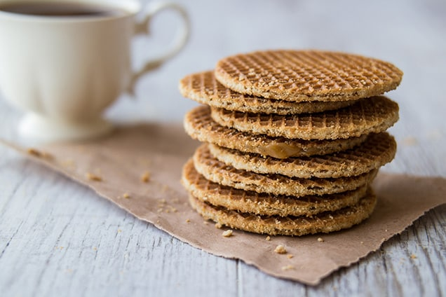 stack of stroopwafels and coffee