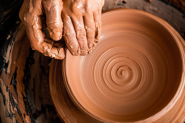creating pottery by hand in a shop