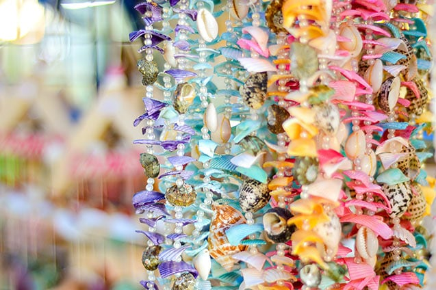 necklaces made of seashells in different colors