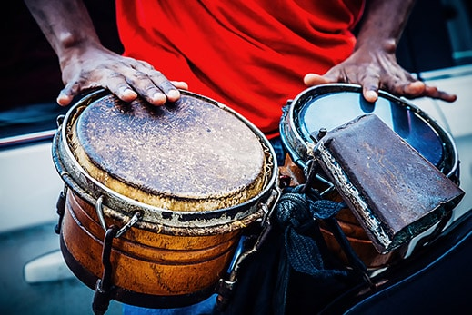 hands of a street musician playing the drums