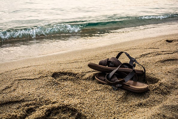 custom leather sandals on a caribbean beach