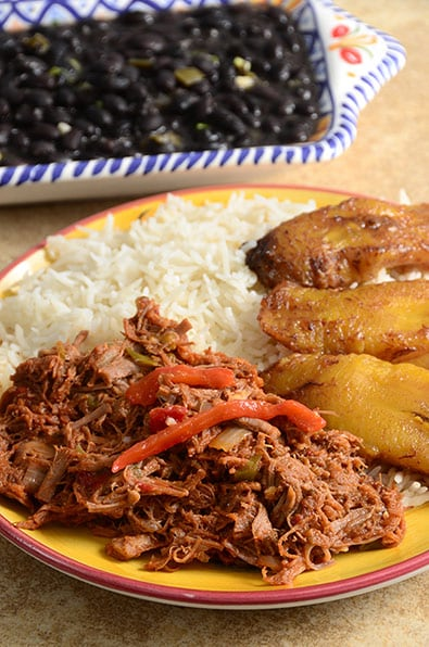 ropa vieja dish with black beans and plantains