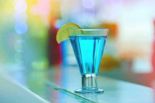 blue curacao liqueur serviced in a glass with lemon