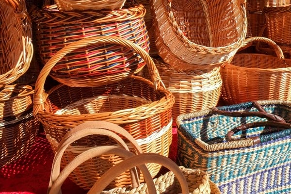 handmade straw baskets in different colors and shapes from dominica