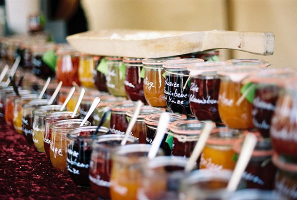 variety of jams and jellies in glass containers