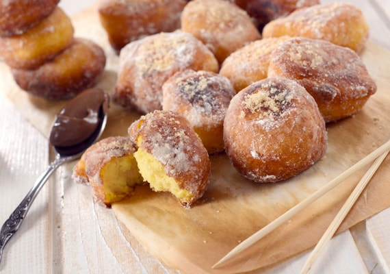oliebollen, a dutch version of doughnuts, served on a wooden plate
