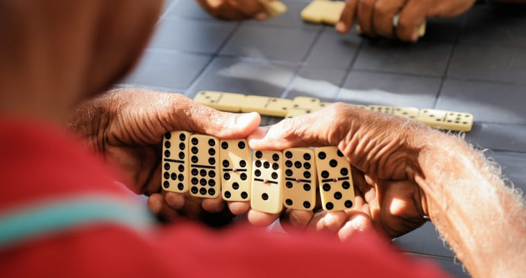 senior man playing dominos in havana cuba